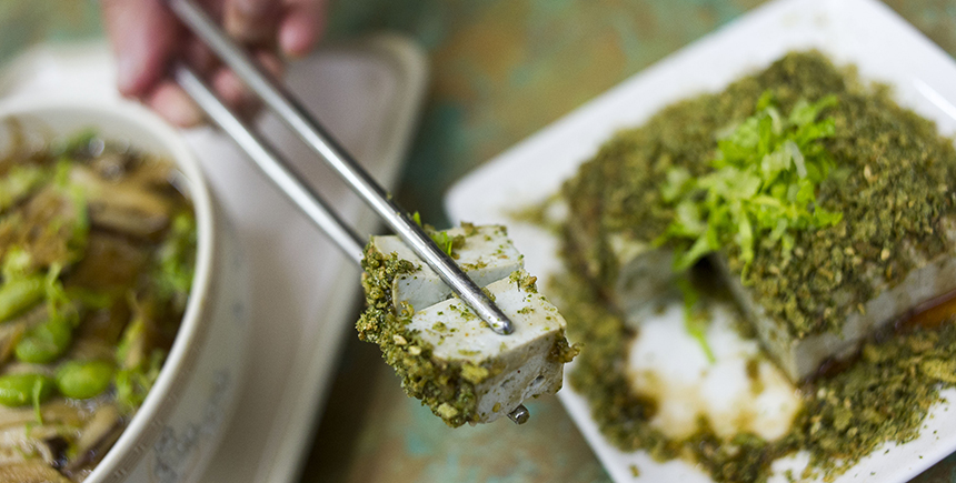 Cold cubes of 'stinky' tofu topped with shredded lettuce and sprinkled with dried seaweed powder, salt and pepper, soy sauce and sesame oil (Photo: Dave Tacon)