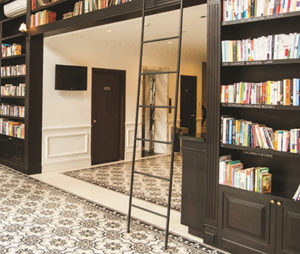 Floor-to-ceiling bookshelves at the lobby of The Alcove Library Hotel
