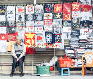 A man sits outside his shop in Hanoi's Old Quarter