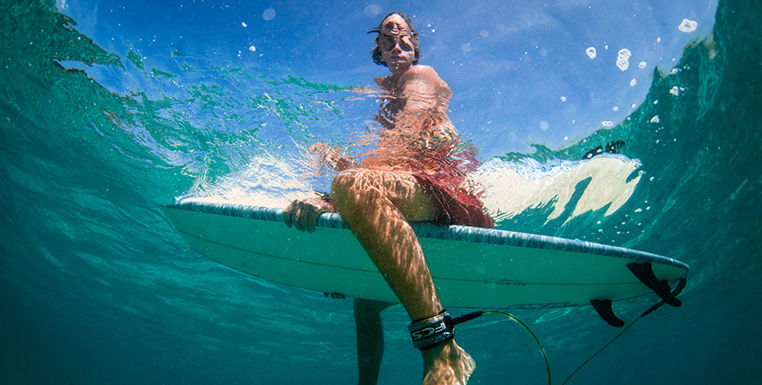 A woman on a surfboard. A dramatic contrast makes for a great shot (Photo: Tommy Schultz)