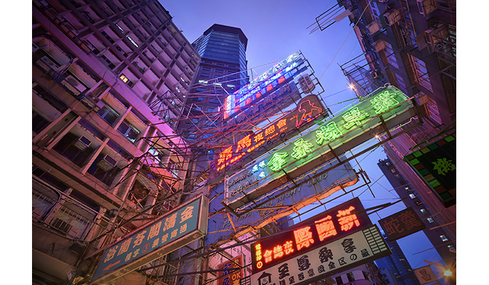 """Above: Taking this photo in Hong Kong's red-light district required some derring-do. """"It was actually quite challenging to create, as I had to put my camera and tripod in the middle of the street, with many cars passing,"""" recalls Jacquet-Lagrèze. """"I had to find the perfect timing, between two cars, to accomplish the shot. On top of that, a bunch of suspicious-looking people stared at me while I was taking the photo."""""""