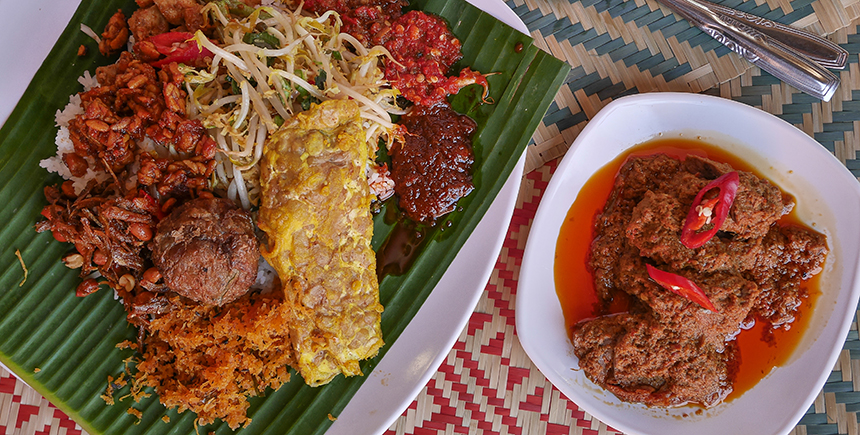 Rendang with assorted dishes at an Indonesian restaurant