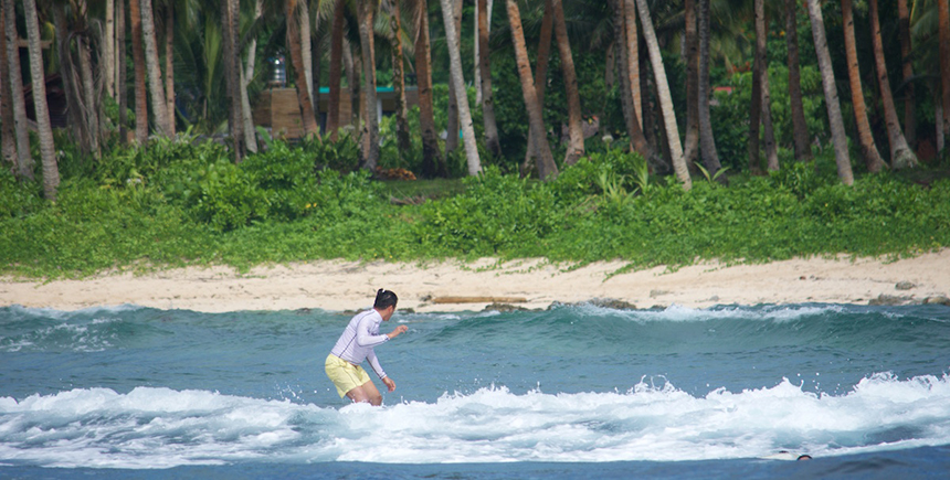 A surfer tests the waters